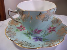 Vintage ROSINA english teacup and saucer soft blue hand painted gilt trim scalloped edges excellent condition