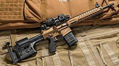 Lewis Machine & Tool's is a modular beast for those of us who believe that failure is not an option! Airsoft Guns, Weapons Guns, Guns And Ammo, M4a1 Rifle, Assault Rifle, Rifle 308, Rifles, Battle Rifle, Custom Guns