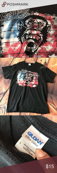 "Mens Faded Black Gas Monkey T-Shirt preowned-large This preowned T-shirt is in very good condition...size large....front picture is red/white/blue with Monkey - 26 inches long from shoulder.  Gas Money Garage is from the TV show ""Fast and Loud""....Ultra Cotton. Gildan Shirts Tees - Short Sleeve"