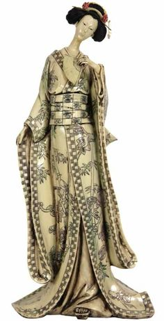 Features:  -Asian style.  -Crafted from excellent quality her robe is carved in traditional scrimshaw of ancient Japanese netsuke.  -Her hair and pins are hand painted.  -Delightful netsuke style repr