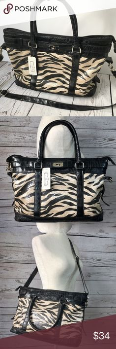 "Aphorism zebra stripe faux reptile / snakeskin bag New Aphorism zebra stripe faux reptile / snakeskin bag.  Brand tag still attached, but no price tag. Black and white zebra print on faux snake skin fabric with black vegan /faux leather  trim & handles. Silvertone hardware. Detachable and adjustable shoulder strap.  Black fabric lining with two open pockets and one zipper pocket. Dimensions:10.5""x14.5""x6"" Aphorism Bags"