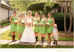 Bridesmaids rocking their cowgirl boots and green dresses.  Green Dresses,  Individualized bouquets for each bridesmaid.  Planning by www.shannalumpkinevents.com