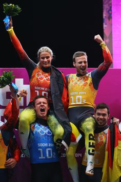 Gold medalists Natalie Geisenberger (top L), Felix Loch (bottom L), Tobias Arlt (top R) and Tobias Wendl of Germany celebrate during the flower ceremony for the the Luge Relay (c) Getty Images Olympic Winners, Bobsleigh, Luge, Olympic Athletes, Winter Olympics, Tobias, Olympic Games