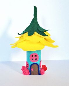 Make an adorable paper tube felt fairy house. It lights up inside if you add a tea light!