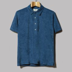 La Paz Navy Polo Shirt: This polo shirt from Portuguese menswear label, La Paz, will see you through the holiday season in perfect sports style.  - Slim fit - Short sleeves - Contrast buttons - All over marl effect