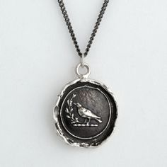 I love Pyrrha!     Creativity Talisman Necklace    This handcrafted talisman necklace features a sparrow holding a sprig of leaves in her beak. She is a master of flight and camouflage, teaching us to use our creativity to solve our problems.