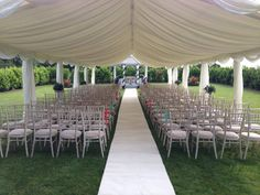 Outdoor wedding ceremony in our secret garden - ivory carpet isle and open side marquee