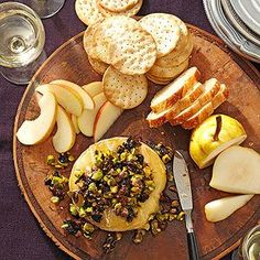 Warm Brie with Fig and Pistachio Tapenade From Better Homes and Gardens, ideas and improvement projects for your home and garden plus recipes and entertaining ideas.