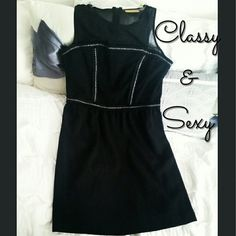 Vera Wang Short Black Dress Beautiful brand new princess Vera wang dress. Zippered back. Silver chain front with sheer upper chest area. Vera Wang Dresses