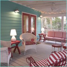 Gorgeous turquoise and red porch. I would've picked a more subtle sofa fabric, though - maybe even white with floral and striped pillows.