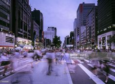 People (motion blurred) crossing the street at the busy Gangnam shopping and business area of Seoul. The Gangnam District is the wealthiest neighborhood of Seoul and features in the worldwide hit 'Gangnam Style' by rapper, Psy.