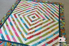 Merry Go Round {A Fun Jelly Roll Quilt} -- WOW! Such a stunning quilt in colors and design! :D