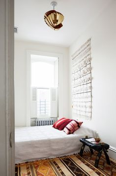 Low bed with a wedding blanket as a wall hanging- simply boho.