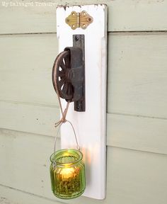 How to turn a rusty old pulley and a piece of scrap wood into a one-of-a-kind tea light holder or night light. From MySalvagedTreasures.com