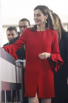 Regal in red: The former journalist, who is mother to Princess Leonor, 12, and Sofia, 10, married into the Spanish monarchy in 2004, becoming queen consort in 2014