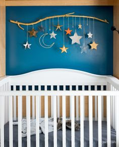 Make your own DIY baby mobile using star ornaments, chain, and a tree branch. Perfect for a baby girl or baby boy nursery. Baby DIY Baby Mobile with Stars and Moon by Scratch and Stitch Baby Room Diy, Baby Bedroom, Baby Boy Rooms, Baby Boy Nurseries, Baby Nursery Diy, Baby Room Decor For Boys, Moon Nursery, Baby Boy Nursery Decor, Star Nursery