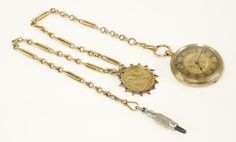A gold fob watch, with a hand engraved gold dial, black Roman numerals and blued hands, marked K18, suspended on a knot and trombone link Albert chain marked 15ct, with a full sovereign fob dated 1912 Sold for £540