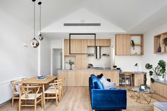 Photo 4 of 1536 in Best Living Ceiling Photos from This Revamped Terrace House Has a Porthole Window for the Owner's Cat - Dwell Recessed Shelves, Timber Shelves, Blue Table Lamp, Boundary Walls, Nesting Tables, Open Plan Living, Amazing Architecture, Victorian Homes, Home Renovation