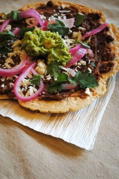 Tlayuda ~Mexican Pizza from Oaxaca.  Very customizable; crust can be made on panini press. Includes a link to a good looking creamy black bean recipe