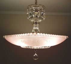 "Vintage Art Deco Pink Square Starburst Glass Ceiling Light Fixture Chandelier | eBay.  This is what you might call a ""fantasy"" light fixture.  The seller has ""gussied it up"" with parts that would not have been on the original.  The original probably consisted of the pink and clear glass bowl and a brass finial and brass canopy/stem with a two bulb socket perhaps.  $225"