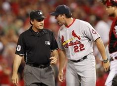 manager Mike Matheny argues the last out with umpire Phil Cuzzi at the end of the game against the Cincinnati Reds at Great American Ball Park. The Reds defeated the Cardinals 4-2. 6-08-13