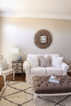 TiffanyD: A fresh coat of paint in my office/sitting room... (peacock mirror, white couch, tufted ottoman)