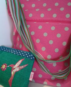 pretty pink spotty cross body bag & hummingbird makeup bag.  Available at Lorient Gift Dun Laoghaire