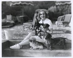 0 Carole Lombard in her backyard-with her cat and her dogs (dachshunds and pekinese)
