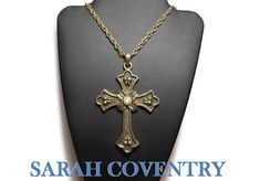 Use code SOCIAL15 for 15% off all purchases over $15, plus FREE shipping on most jewelry! Sarah Coventry cross pendant, Peace Cross, Limited Edition 1975, large antiqued gold tone with original chain, large bail, faux pearl center. It has a maple leaf motif and ... #etsygifts #vintage #vjse2 #jewelry #gift