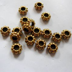6mm Tibetan Style Antique Gold Daisy Spacers by BeadFindingUtopia, $2.50