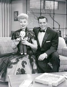 """1955: Lucy & Desi on the """"Hollywood"""" set with the American Character Doll Company's Little Ricky doll."""