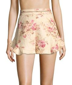 """flutter linen shorts by Zimmermann. Floral linen shorts updated with a picot trim. Banded waist. Concealed back zip. Cotton lining. Rise, about 9"""".Inseam, about 2"""".Linen. Imported. Model shown is 5'10"""" (177cm) wearing US size Small. #zimmermann #shorts"""