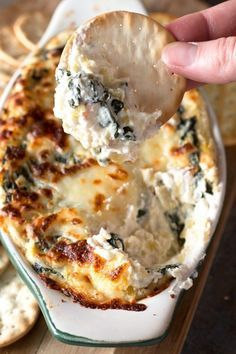Spinach and Artichoke Goat Cheese Dip is a tangy twist on your favorite warm and gooey dip! Goat cheese brings an extra layer of savory flavor to the party that is simply irresistible. Everyone will be gobbling it up in mere minutes! Snacks Für Party, Appetizers For Party, Crackers Appetizers, Vegetarian Recipes, Cooking Recipes, Healthy Recipes, Dip Recipes, Potato Recipes, Cooking Tips