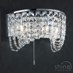 Geneve 218070306 by Trio Lighting Trio | Geneve 218070306 https://www.shinelighting.co.uk/all-lighting/interior-lighting/geneve-218070306 A modern decorative crystal wall light.  Finished in chrome.   3 x 28w G9 Mains voltage halogen Lamps (3 x 370 lumens) (Included)   Height: 18cm   Width: 30cm   Proj: 18.50cm  £222.66