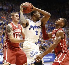 Kansas forward Cliff Alexander (2) swings the ball between Oklahoma forward Ryan Spangler (00) and guard Buddy Hield (24) during the first half on Monday, Jan. 19, 2015 at Allen Fieldhouse.