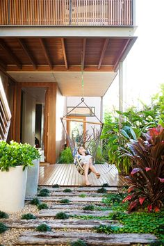 Nina loves to play in the swing located by the front door. The surrounding greenery is lush and includes a herb garden and a privacy screen planted by the neighbours.