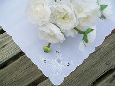 White Cloth Napkins Linen with Scalloped Edges and Cut Out Floral Embroidery Details Set of 4  by:-Yliana