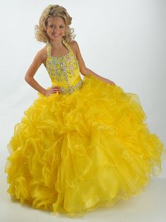Gorgeous Ritzee Girls Pageant Dress 6346. This floor length pageant gown features a halter neckline, beaded and embroidered bodice, and lace up back. Completing the look of this dress is a ruffled ball gown skirt. This beautiful dress is a perfect choice for your 2012 pageant. Available in Yellow, Fuchsia, Royal and White.