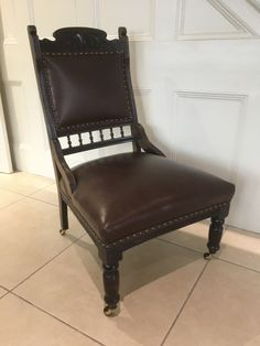 Victorian Armchair, studded, in leather