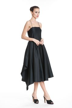 Artful Anne Frock - This black frock will give you a polished and more refined look.  Its fitted top and flowy skirt, with extended fabric on the sides, create an elegant look for any special occasion.