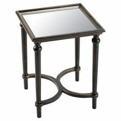 """Perfect for displaying a bouquet of fresh blooms or family photos, this eye-catching accent table showcases a mirrored surface and espresso-hued legs.    Product: Accent tableConstruction Material: Solid wood, engineered wood and mirrored glassColor: Espresso and antique goldFeatures:  Mirrored glass topTurned legs Dimensions: 20"""" H x 20"""" W x 20"""" D"""
