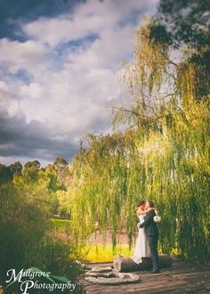 Bride and groom by the lake at Inglewood Estate