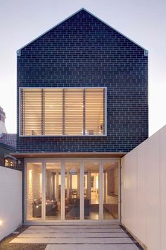 The Lincoln House by Kreis Grennan Architecture is the transformation of a dark and dilapidated one-storey terrace in the Sydney suburb of Stanmore into a beautiful modern three storey family home.