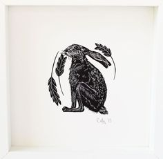 """""""Hare"""" by Cally Conway. Linocut on Paper, Subject: Animals and birds, Illustrative style, From a limited edition of 25, Signed and numbered on the front, This artwork is sold unframed, Size: 23 x 23 cm (unframed), 9.06 x 9.06 in (unframed), Materials: Three colour woodcut print on Fabriano Rosaspina Archival handmade paper"""