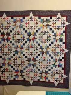 scrappy quilt - not a storm at sea, just two really cool alternating blocks.