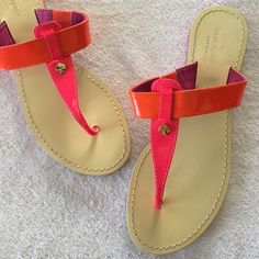 Kate Spade Sandals Thus pair of Kate Spade Sandals are a size 7 and excellent condition as you can see in the pictures. The soles have a small amount of wear   The tops look untouched. Super cute neon orange and neon pink. Great addition to your summer wardrobe kate spade Shoes Sandals