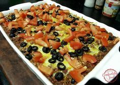 A full on taco dinner in casserole form, this dish covers it all. Layered tortilla chips on the bottom, topped with cheesy refried beans and seasoned grou