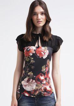 Blusa negra con estampado de flores