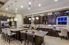The extended island in our Gourmet Kitchen gives the whole family room to gather. Biscayne model, New Homes Tampa