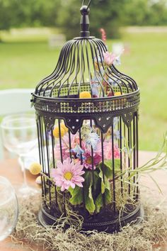 Birdcage centerpices with wildflowers